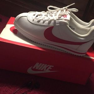 Some white and red Nike Cortez
